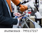 engineer hand using tablet with ... | Shutterstock . vector #795117217