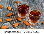 Small photo of Italian amaretto liqueur with dry almonds