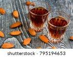 Small photo of Italian amaretto liqueur with dry almonds