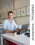 handsome young man working on... | Shutterstock . vector #795268063