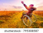 happy woman at sunset. a young...   Shutterstock . vector #795308587