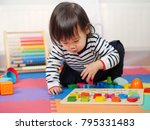 baby girl learning alphabet at...   Shutterstock . vector #795331483