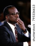 Small photo of Washington DC. USA,10th September 1991 Clarence Thomas nominee for Associate Justice of the United States Supreme Court ponders questions from Senate Judiciary Committee during confirmation hearings