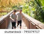 little sibling boy walking... | Shutterstock . vector #795379717
