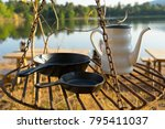 old retro iron camp kettle and... | Shutterstock . vector #795411037