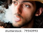 man in cowboy hat smoking | Shutterstock . vector #79543993