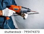 man with electric drill | Shutterstock . vector #795474373
