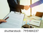 two businessmen are shaking... | Shutterstock . vector #795484237