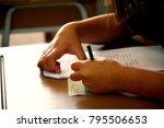hands with pen over application ... | Shutterstock . vector #795506653