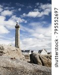 Small photo of Lighthouse near the coast in the ocean in Penmarch, Brittany, France