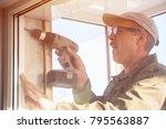 carpenter in glasses working... | Shutterstock . vector #795563887