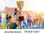 young athlete holding trophy.... | Shutterstock . vector #795597397