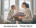winter portrait of happy loving ... | Shutterstock . vector #795615823