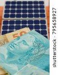 solar panel with brazilian money   Shutterstock . vector #795658927
