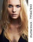 Small photo of Young blond woman. Beautiful blonde Girl face with blue eyes