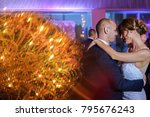 bride and groom on dance floor... | Shutterstock . vector #795676243