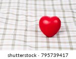 red heart sign on table cloth... | Shutterstock . vector #795739417