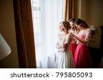 pretty bridesmaids in pink... | Shutterstock . vector #795805093
