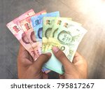 thai banknote money in hand ...   Shutterstock . vector #795817267