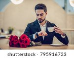 handsome businessman is sitting ... | Shutterstock . vector #795916723