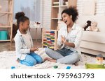 mom and daughter are engaged in ... | Shutterstock . vector #795963793