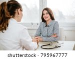 young woman at doctor's office. | Shutterstock . vector #795967777