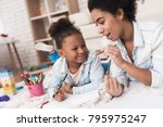 mom and little girl lie on the... | Shutterstock . vector #795975247