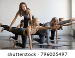 young female yoga instructor... | Shutterstock . vector #796025497