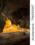 Small photo of Golden statue of Buddha of Nirvana in buddhist cave temple in Wat Tham Suwankhuha cave (Monkey Cave) In Phang Nga, Thailand.
