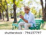 asian man using smartphone... | Shutterstock . vector #796157797