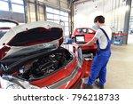 mechanic repairs motor from an...   Shutterstock . vector #796218733