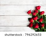 Red Roses On A Old Wooden Table