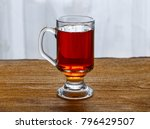 Tea In A Glass Cup On A Wooden...