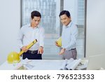 architects engineer discussing... | Shutterstock . vector #796523533