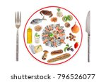 Small photo of Allergy food concept. Various allergenic types of food on prepare plate with knife and fork over white