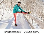woman running in snowy park... | Shutterstock . vector #796555897