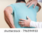 the orthopedist does a checkup... | Shutterstock . vector #796594933