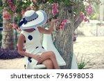 happy girl relaxing on exotic... | Shutterstock . vector #796598053