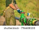 oil worker is turning valve on... | Shutterstock . vector #796608103