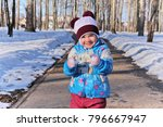 little girl clenched her fists... | Shutterstock . vector #796667947