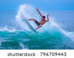 riding the waves. costa rica ... | Shutterstock . vector #796709443