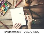 the artists hand drawing a paint | Shutterstock . vector #796777327
