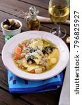 Small photo of Plate of vegetarian soup with stuffed agnolotti.