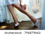 beautiful legs of the bride   Shutterstock . vector #796879663