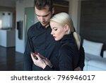 sad couple recieving... | Shutterstock . vector #796946017