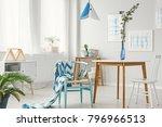 patterned blanket on blue chair ... | Shutterstock . vector #796966513