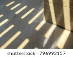 the sun shines on marble wall... | Shutterstock . vector #796992157