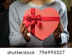 red gift box with ribbon in the ... | Shutterstock . vector #796993327
