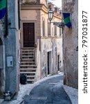Small photo of Amelia (Terni, Umbria, Italy): historic buildings in the old town. Typical street at evening