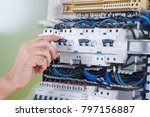 electrician trying buttons of a ... | Shutterstock . vector #797156887